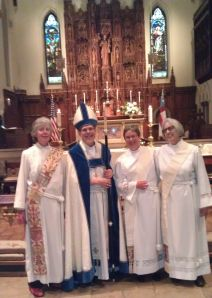 Bishop Lane with new deacons, left to right, Jane Chatfield, Corey Walmer, Lanny Wenthe
