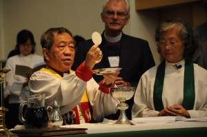 Bishop David Lai of Taiwan celebrates the Eucharist at St. John's Cathedral. (Photo by ENS/Mary Frances Schjonberg)