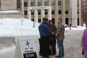 Bishop Steve offering Ashes to Go in Portland last year.