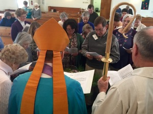 Bishop Lane leads the people of St. Patrick's in the renewal of their Baptismal vows. Photo by Mark Spahr